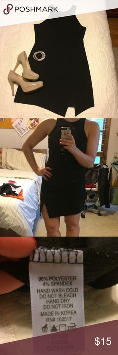 Little black dress with bottom cutout So cute for a girls night out or a date! Little black dress with triangle cutout along bottom hem. I am more of a medium and it fits me even though it is a large. Fabric is very giving so it's stretchy and would look good on many body sizes. Soprano Dresses Mini