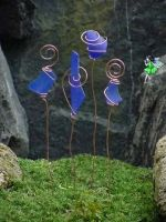 SBG wants to make these!    Faux Sea Glass Garden Stakes......  Beautiful garden stakes created with copper tubing available at any hardware store. The glass is tumbled faux sea glass but looks fairly real.