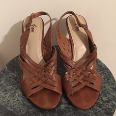 Brown Criss Cross Design Heels Like New, only wore for two hours. Super Cute. Priced to Sale. Price is Firm. Bundle to Save More:) FIONI Clothing Shoes Heels