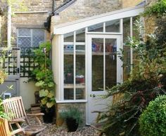 Greenhouse lean to for L-shape corner of house.