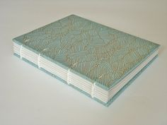 I'm going to make some paste paper with a similar design. LOVE the colors here | Japanese wave exposed spine journal - small
