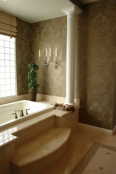 Jacuzzi Bath with Column - love the wall treatment