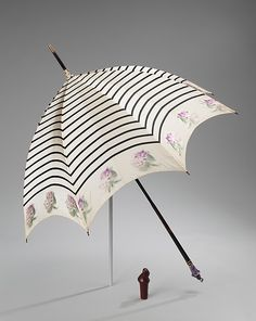 Parasol Designer: Betaille (French) Date: 1900–1910 Culture: French Medium: silk, wood, metal, leather, quartz, glass, enamel, tortoiseshell Dimensions: 39 in. (99.1 cm)