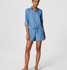 A total can't-resist, kick back in the casual cool of chambray with this flattering drawstring romper. Point collar.…