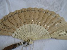 ANTIQUE (circa 1800s) Pierced Ivory  Silver Sequin Hand Fan. $227.00, via Etsy.
