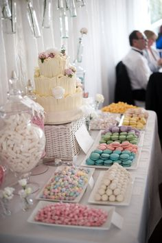 Why go with just a wedding cake, when you can have a whole dessert bar? These are becoming more and more popular. Match the desserts to your wedding colors. (LOVE these colored macaroons!)..