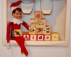 Elf on the Shelf being sneaky at the drink dispenser machine....