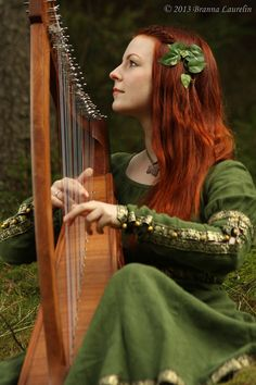 Beautiful lady with beautiful red hair and the wonder of thee harp..