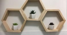 Use popsicle sticks and glue to create stunning mid century modern honeycomb shelves. No one will guess they're made of popsicle sticks!