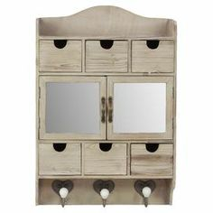 """Add rustic style to your entryway or office with this weathered wall cabinet. 6 drawers, a top shelf, and 2 mirrored cabinets are perfect for stowing accessories, while 3 bottom hooks hang keys and scarves.   Product: CabinetConstruction Material: Wood, metal and mirrored glassColor: Light naturalFeatures: Antique-inspired designDimensions: 25.5"""" H x 17.5"""" W x 5.5"""" D"""