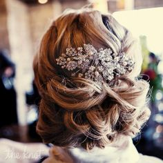 Romantic low updo with crystal and hairpin // Hair Stylist: Erica Cricket Miner, Kansas City // photo by: One Tree Studios // http://www.theknot.com/weddings/photo/romantic-low-updo-110850