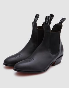 In an exclusive collaboration from R.M. Williams and Need Supply Co., dress Chelsea boots in Black Yearling. Pulls on. Almond toe with Santa Fe floral stitching. Elastic goring at lateral and medial sides. Pull tabs at ankle with woven logo detailing. Lea