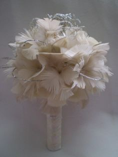 feather bouquet. I love it. It would match my dress perfectly