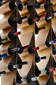 A Leather Wine Wall Doubles As Art In This Restaurant This renovated restaurant in Toronto, features a unique custom designed wine display made from leather that cradles the bottles of wine. Wine Display, Bottle Display, Wine Cellar Design, Wine Design, Wine Shelves, Wine Storage, Bar A Vin, Wine Wall, Wine And Liquor