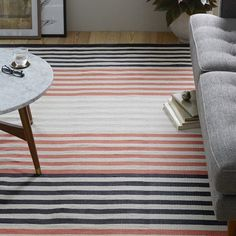 The Colorstep Stripe Cotton Dhurrie features alternating stripes, which add a graphic touch to the hallway or kitchen. Handwoven by Craft-mark certified Indian artisans, this rug's flat weave construction makes it really durable.