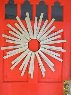 paint stick stirrer wreath, would look cool painted