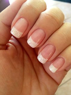 Use iridescent white glitter. White tips fully dipped in glitter. Round tips. Longer rather than shorter length. Small white heart on pink part of nail on wedding finger.