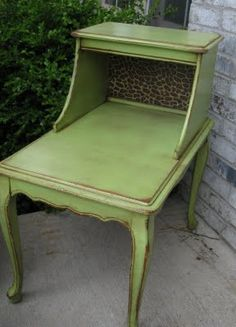(Green apple spray paint w/ distressing & glaze) I could totally do this!  we have a similar table in our basement.