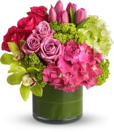 Hydrangea, rose and tulip bouquet. Love the idea of lining a vase with green leaves!