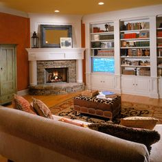 Corner Fireplace and book shelves. My husband and I personally have a corner fireplace in our basement with a TV about it and we spend almost every evening there. Love it!