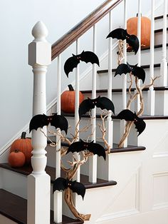 Hang bats from garland or stairwell for Halloween. So cute! Nixon would love hitting these on the way up the stairs! Bat garland. Halloween stair ideas.