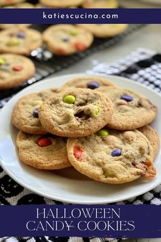 These Candy Cookies have the base of a traditional chocolate chip cookie, and incorporates any leftover candy bars you might have laying around! The sky is the limit--chop up your favorite candy bars and add them in these sweet cookies. #cookies #halloweencandy #candycookies