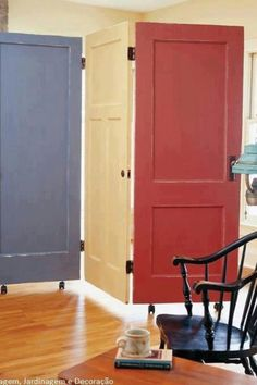 Recycled doors turned to room divider - cool idea to use the wheels if you would want it to open up when guests aren't there