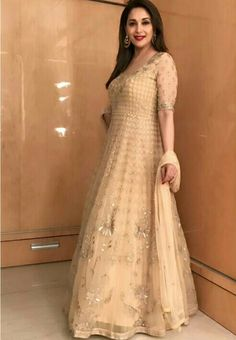 Gorgeous in gold @MadhuriDixit in a beautiful handcrafted Anita Dongre anarkali