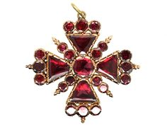 This brooch is in fantastic condition. The flat cut garnets are foiled at the back and literally glow and sparkle. It was made circa 1820. It can also be worn as a pendant. The eight points of the 15th century cross which the Knights of Malta adopted as their symbol mean: – to live in …