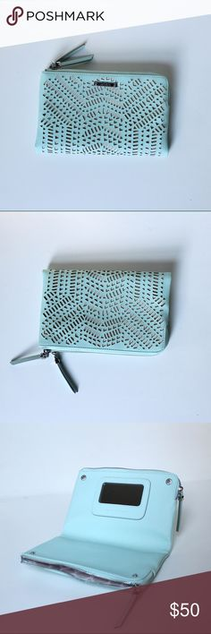 """NWOT Stella & Dot Laser Cut Double Zip Clutch Bag Stella & Dot laser cut vegan mint leather clutch purse or makeup organizer has two seperate zipper compartments, credit card slots, and built in mirror. Spill proof inerior. 8.75"""" x 5.5""""  NWOT Perfect condition Stella & Dot Bags Clutches & Wristlets"""