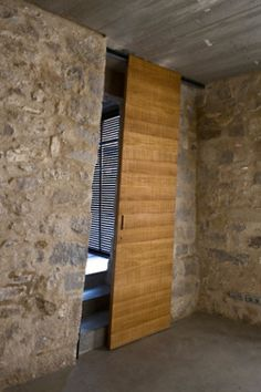 Sliding doors don't have to be perpendicular. Door in Medieval Building Turned Into Contemporary Living Space. Located in the core part of Girona's medieval quarter and overlooking the Plaça de Sant Domènec, Spain. Architecture Design, Architecture Renovation, Minimal Architecture, Facade Design, Building Architecture, The Design Files, Sliding Doors, Front Doors, Entry Doors