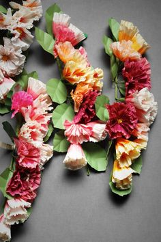 paper flower garland, so pretty but it's $1500. There has to be a better way...!