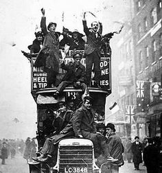Taking over a London bus in the Armistice day celebrations, 1918