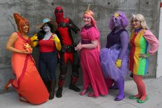 https://flic.kr/p/sPnGVQ | Flame Princess, Marceline the Vampire Queen, Princess Bubblegum, Lumpy Space Princess, and Lady Rainicorn, all from the American TV cartoon Adventure Time; surrounding Deadpool, from Marvel Comics | Photos by: Beppe Sabatini  Email: bsabatini@hotmail.com Portfolio: https://www.flickr.com/photos/8703833@N08/sets/72157633608989882/ Cosplay Portfolio: https://www.flickr.com/photos/8703833@N08/sets/72157637827123485/