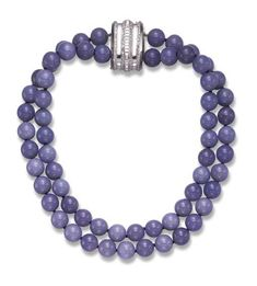 A BLUE CHALCEDONY, DIAMOND AND WHITE GOLD NECKLACE, BY SUZANNE BELPERRON  Designed as a two-strand blue chalcedony bead necklace, joined by a detachable platinum clip, with square and single-cut diamond trim, 15¼ ins., circa 1935, with French assay marks and maker's mark  With maker's mark for Groene et Darde