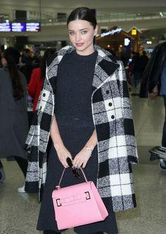 International supermodel Miranda Kerr wearing Fay Tartan wool coat from Fall - Winter 2015/16 collection.