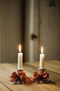 How to Make Tapered Candles Stand - drip some wax, then stand taper in wax. The wax will quickly dry securing the taper in place