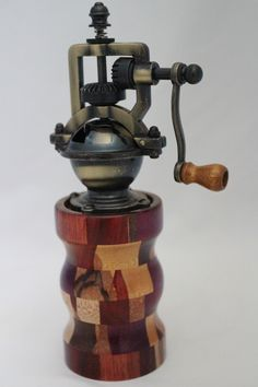 "This peppermill has an antique-style peppermill mechanism that adjusts easily from coarse to extra fine. The metal is an Antique Brass finish. It does not accommodate salt since it is metal. The body of the mill contains 120 pieces of exotic woods. It is approx. 2.5""dia. x 8""H. Cards for the Care of Wood and the names of all the woods and origin are sent with the purchase. # 619  0807"