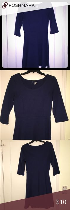 Navy blue three quarter sleeve dress Such an awesome dress! I wore both to work and out with a fun necklace. Can be dressed up or down. Tailored fit and very flattering. Dresses