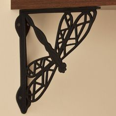 Dragonfly Cast Iron Shelf Bracket - Black Powder Coat by Whittington Collection. $18.95. Sturdy cast iron construction and a fun design make the Dragonfly Iron Shelf Bracket a natural addition to your home. Shown in Rust finish. Bracket dimensions: 9-1/2 L x 9-3/4 H. Bracket is 3/4 wide; 1-1/2 wide where the mounting screws are placed. Made of durable cast iron. Rust finish is actual oxidized iron, a living finish. Sold individually. Includes matching fastening hardware.
