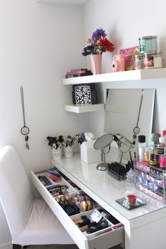 A whole corner table dedicated to holding makeup is ideal if you have the space in your home! Divided sections within a pull-out drawer keep everything organised and easy to access
