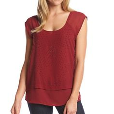 "SALE $32Red Sleeveless Studded Top - NWT DKNY JEANS Red Sheer Sleeveless Studded Top - New With Tags. Featured in syrah (deeper red); scoop neck; sleeveless (cap sleeve like; black studded details. Material: 100% polyester...machine washable. Non-stretchy... measurements taken laying flat. Measures 18.5"" across bust line and 27"" in length. Mannequin in pics 2,3,4 is size 8 to help you with sizing. This is such a gorgeous top and can be worn year round. MSRP is $79.50. 2 available! DKNY JEANS…"