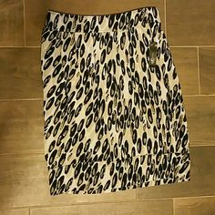 Skirt Polyester leopard print skirt with front pockets... I'm 5'7 and it hits just below the knees never worn East 5th Skirts Midi