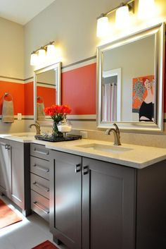Adding a simple stripe of bold -- such as orange -- paint is an easy way to turn a neutral space into one that pops with panache. Seen in the mirror's reflection, a striking painting echoes the color of the stripe, completing the colorful bathroom.