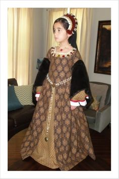 This was my second attempt at a Tudor costume. I modified the dress for another little girl (I was a lot happier with the alterations! I hope she and . Child's Brown Tudor Dress and French Hood Renaissance Costume, Medieval Costume, Renaissance Clothing, Medieval Dress, Historical Clothing, Tudor Costumes, Period Costumes, Little Girl Dresses, Girls Dresses