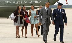 President Barack Obama and daughter Sasha, third left, along with two of Sasha's friends, board Air Force One as they leave Washington for their weekend in New York.