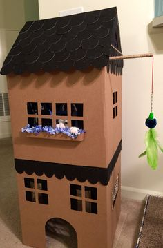 DIY - Simon DeMott kitty playhouse - Adapted from Martha Stewart's cardboard cat house template. http://www.marthastewart.com/921522/how-make-cardboard-cat-playhouse