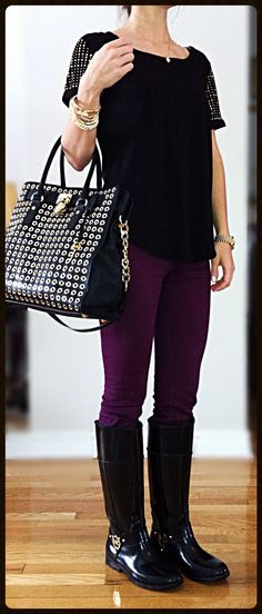 Casual classy outfit-  Black studded T-shirt, Urban outfitter purple jeans, Black MK boots & bag, MK gold watch