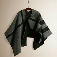 Iconic cape! Burberry Prorsum Mega Check cape Hottest item this year! Gorgeous brand new Burberry Prorsum Mega Check cape in black and grey. Material and labels exactly like the original but the price. Super warm. Great for the winter season and upcoming spring. Burberry Jackets & Coats Capes