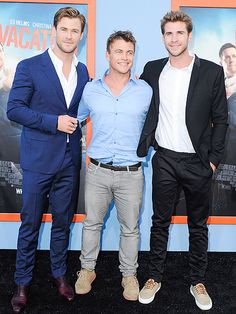 Star Tracks: Tuesday, July 28, 2015 | TRIPLE THREAT  | Chris Hemsworth gets a little brotherly love from Luke and Liam at the Westwood, California, premiere of his newest film, Vacation, on Monday.